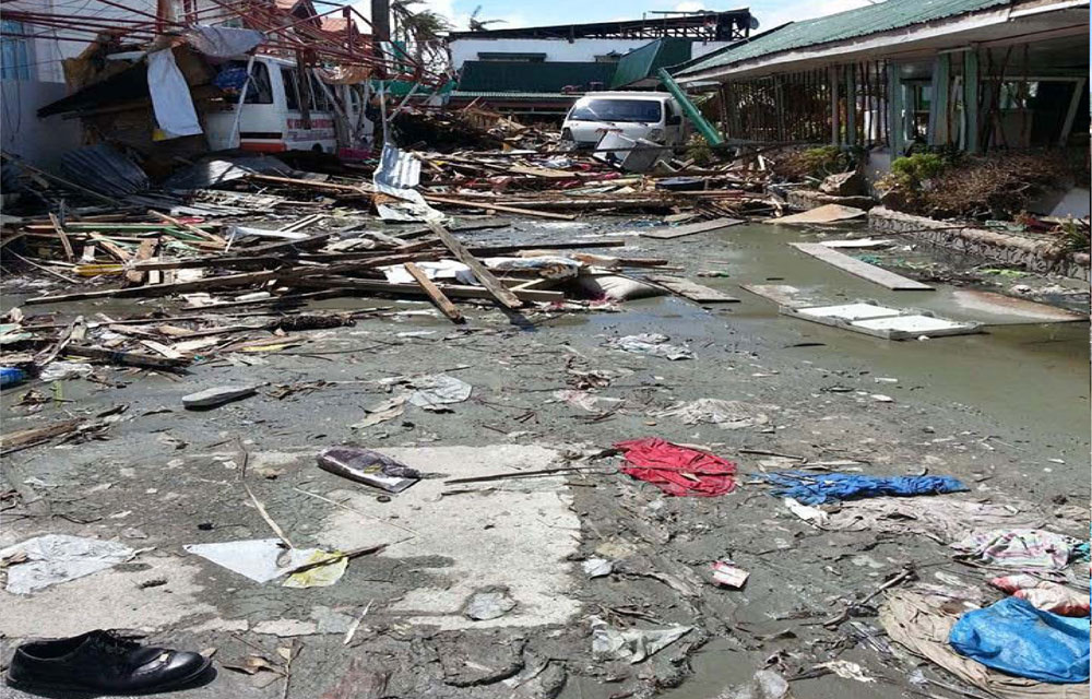Front view of our school after Yolanda incident. We cannot get inside the building because of debris scattered around the place.